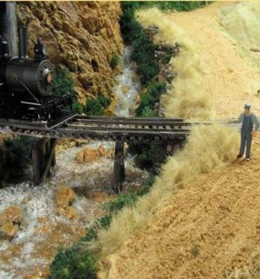 Photo of grass made from faux fur on a model railroad layout
